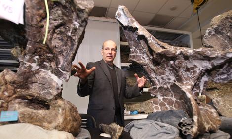 Kenneth Lacovara with dinosaur bones