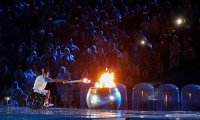 Brazilian swimmer Clodoaldo Silva lights the Paralympic flame