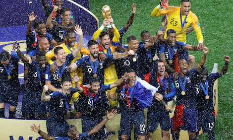 French players hold up the trophy as they celebrate the FIFA World Cup championship.